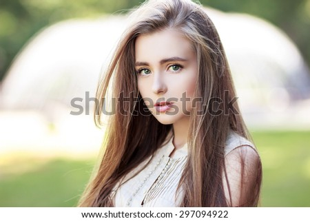 Portrait of a beautiful sexy young girl with perfect skin and make-up closeup. Emotional photo - stock photo