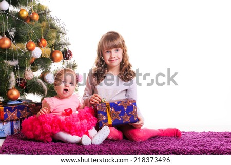 portrait of a beautiful sisters. christmas tree, new year - stock photo