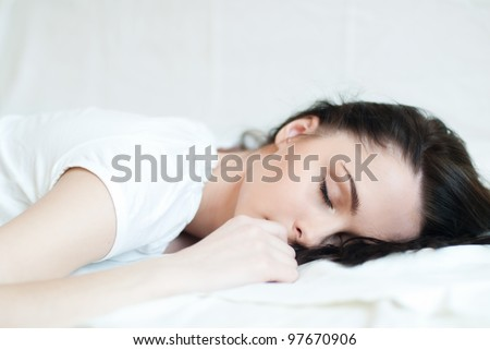 portrait of a beautiful sleeping brunette