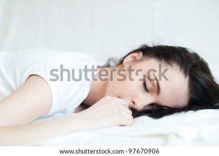 portrait of a beautiful sleeping brunette - stock photo