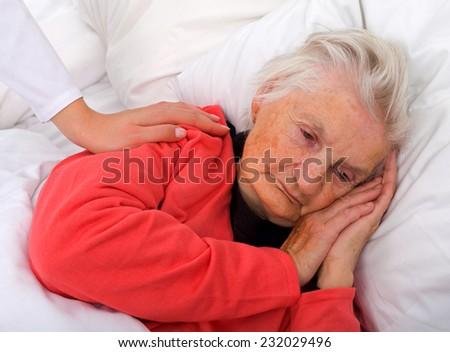Portrait of a beautiful sleeping elderly lady - stock photo
