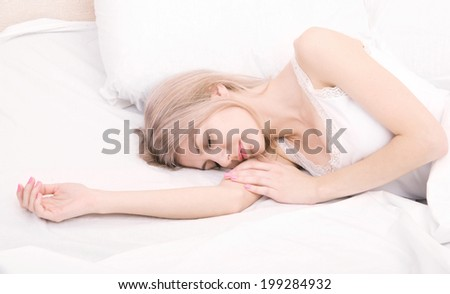 portrait of a beautiful sleeping woman - stock photo