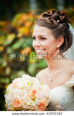 Portrait of a beautiful smiling bride - stock photo