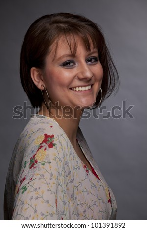 portrait of a beautiful smiling brunette young woman - stock photo