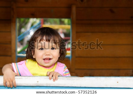 portrait of a beautiful smiling child - stock photo