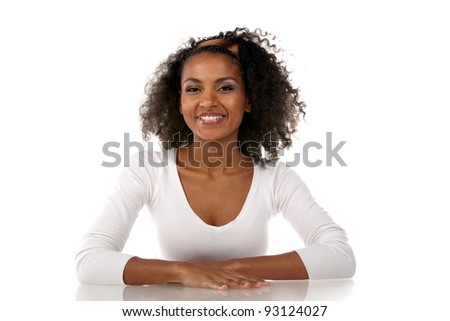 portrait of a beautiful smiling dark-skinned woman in a white dress in the studio - stock photo