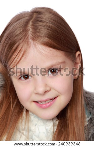 Portrait of a beautiful smiling little girl isolated on white