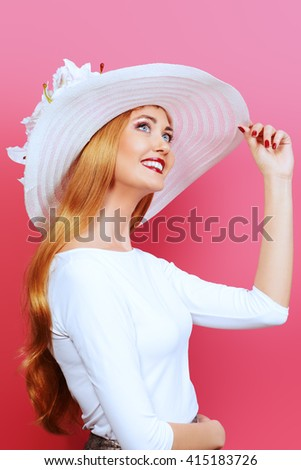 Portrait of a beautiful smiling woman in elegant hat over pink background. Beauty, fashion. Summer vacation. - stock photo