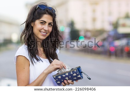 portrait of a beautiful smiling woman outdoor  - stock photo