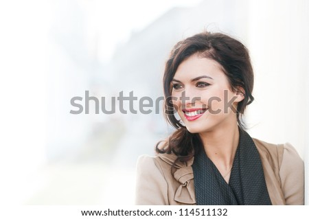 portrait of a beautiful smiling woman outdoors - stock photo