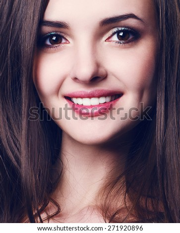 Portrait of a beautiful smiling young woman - stock photo