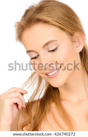 Portrait of a beautiful smiling young woman with natural make-up. Spa girl. Skincare, healthcare. Healthy teeth. Studio shot. Isolated over white. - stock photo