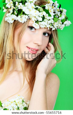 Portrait of a beautiful spring girl in apple tree flowers. - stock photo