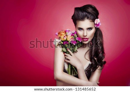 Portrait of a beautiful spring girl with fresh nosegay - stock photo