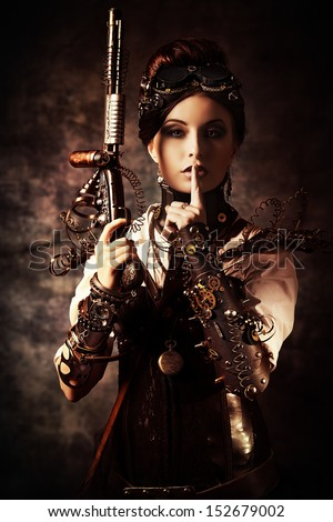 Portrait of a beautiful steampunk woman holding a gun over grunge background. - stock photo
