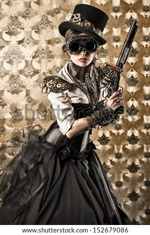 Portrait of a beautiful steampunk woman holding a gun over vintage background. - stock photo