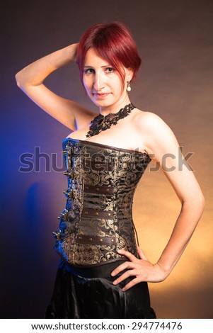 Portrait of a beautiful steampunk woman isolated on vintage background. - stock photo