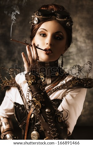 Portrait of a beautiful steampunk woman over grunge background. - stock photo