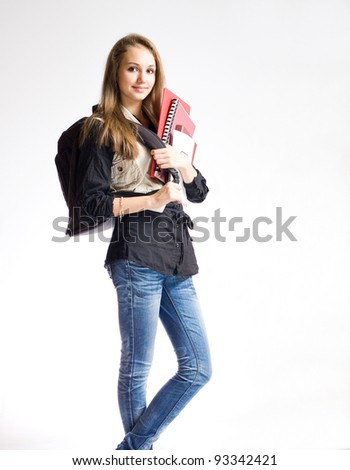 Portrait of a beautiful student girl with black backpack and books. - stock photo
