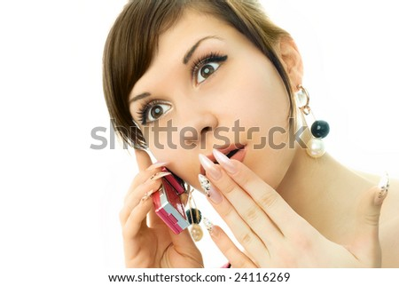 portrait of a beautiful surprised girl talking on the cell-phone - stock photo