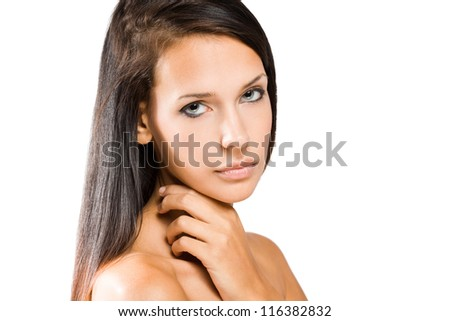 Portrait of a beautiful tanned young brunette woman.