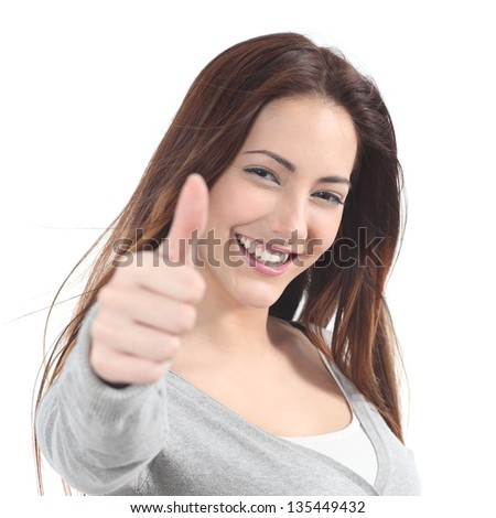 Portrait of a beautiful teen with thumb up gesture on a white isolated background - stock photo