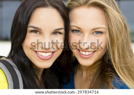 Portrait of a beautiful two young girls smiling