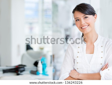 Portrait of a beautiful woman at the hair salon - stock photo