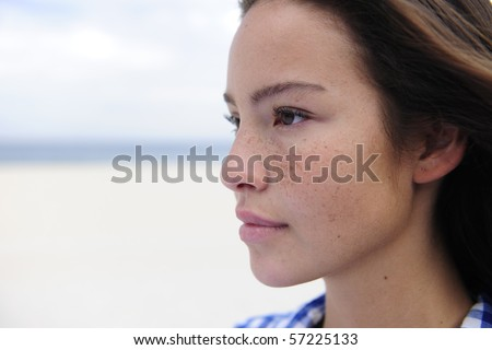 portrait of a beautiful woman at the sea with copy space - stock photo
