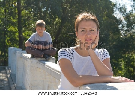 portrait of a beautiful woman. boy at background