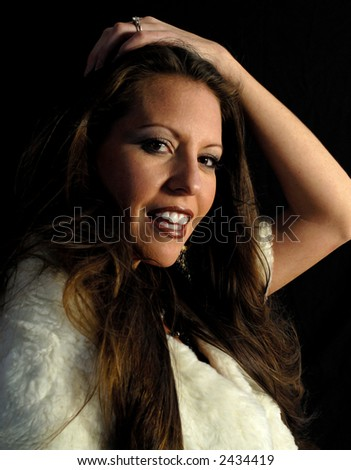 Portrait of a beautiful woman copy space isolated on black - stock photo