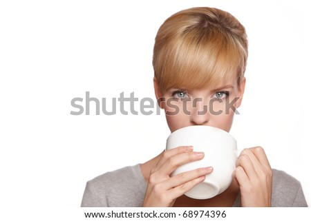 Portrait of a beautiful woman, drinking tea or coffee, isolated on white - stock photo