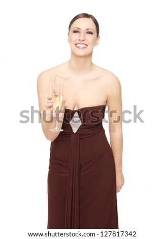 Portrait of a beautiful woman holding champagne glass - stock photo