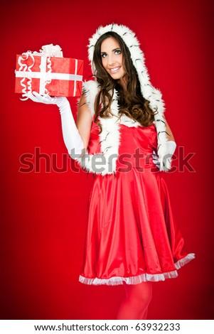 portrait of a beautiful woman holding xmas present - stock photo