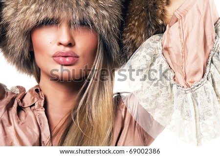 Portrait of a beautiful woman in luxurious clothing - stock photo
