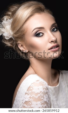 Portrait of a beautiful woman in the image of the bride with flowers in her hair. Picture taken in the studio on a grey background. Beauty face - stock photo