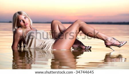 Portrait of a beautiful woman in the water