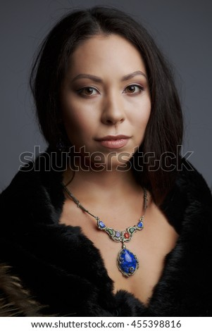 Portrait of a beautiful woman in traditional dress drilled