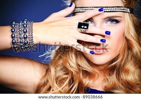 Portrait of a beautiful woman. Jewelry, make-up. - stock photo