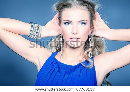 Portrait of a beautiful woman. Jewelry, make-up. - stock photo