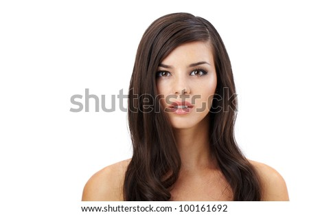 Portrait of a beautiful woman looking at camera - stock photo