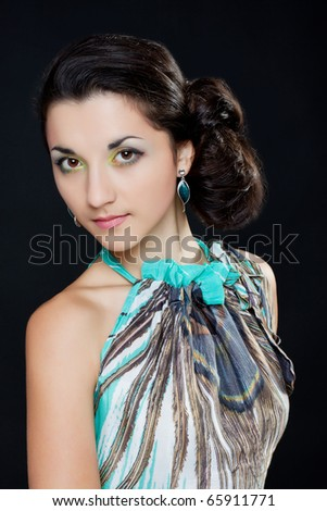 Portrait of a beautiful woman on a black background with a bright make-up - stock photo