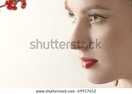 portrait of a beautiful woman  on a light background - stock photo