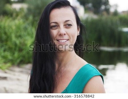 Portrait of a beautiful woman on the nature
