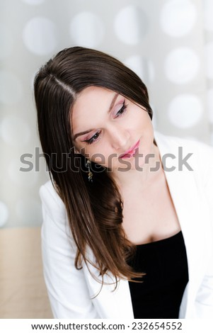 Portrait of a beautiful woman thinking and looking worried  - stock photo