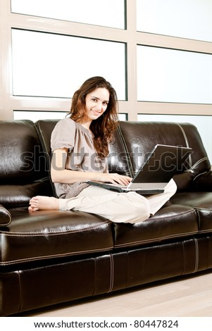 portrait of a beautiful woman using a laptop - casual still life