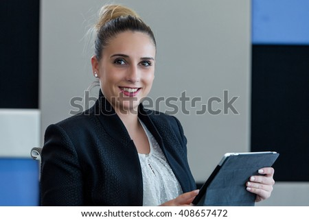 Portrait of a beautiful woman using tablet