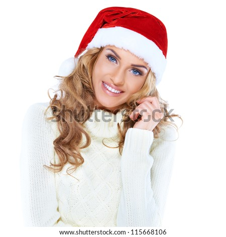 Portrait of a beautiful woman wearing a santa hat smiling - stock photo