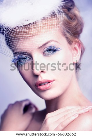Portrait of a beautiful woman wearing a veil   isolated on white - stock photo