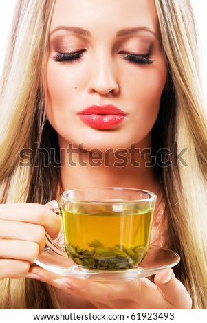 Portrait of a beautiful woman with a cup of green tea - stock photo